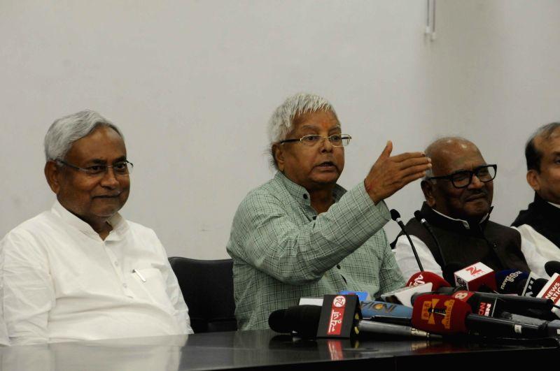 :Patna: RJD leader Lalu Prasad Yadav and JD(U) leader Nitish Kumar during a press conference in Patna on Nov 8, 2015. (Photo: IANS). - Narendra Modi