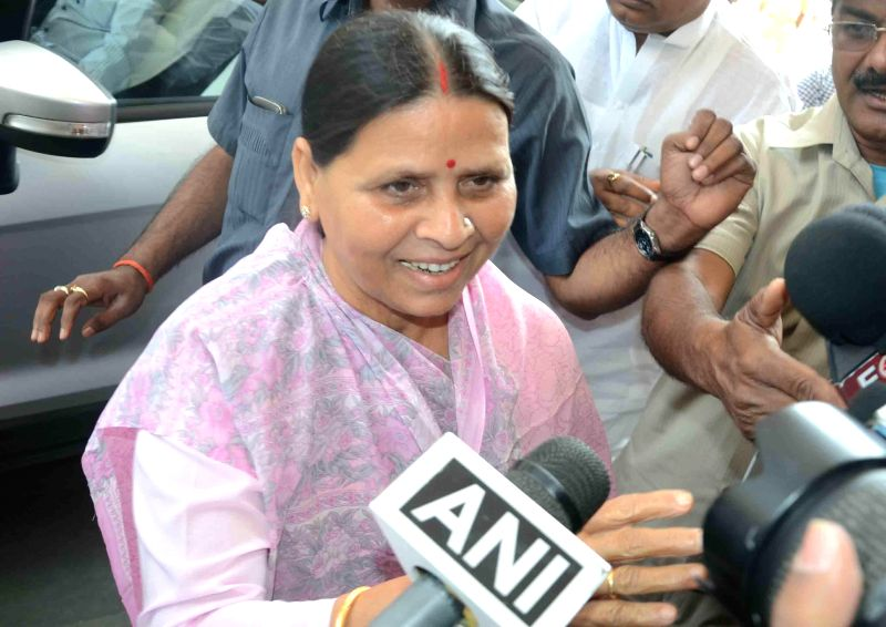 RJD leader Rabri Devi arrives at the Bihar assembly in Patna, on March 16, 2015.