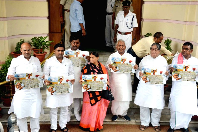 :Patna: RJD legislators led by party leader Rabri Devi stage a demonstration against Prime Minister Narendra Modi and state's Chief Minister Nitish Kumar, in Patna on July 23, 2018. (Photo: ...