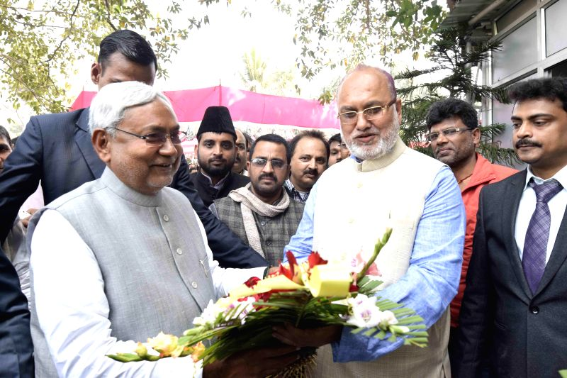 RJD Legislature Party leader Abdul Bari Siddiqui greets JD(U) leader Nitish Kumar as he arrives at his residence for a lunch in Patna, on Feb 18, 2015.