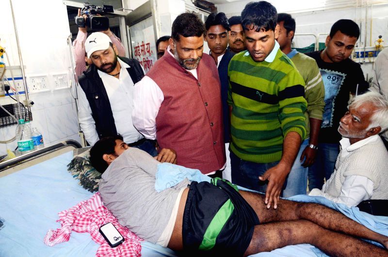 RJD MP from Madhepura Pappu Yadav visits JD(U) student leader admitted at Patna Medical College and Hospital (PMCH) after being beaten-up by police, in Patna on Dec 2, 2014. - Madhepura Pappu Yadav