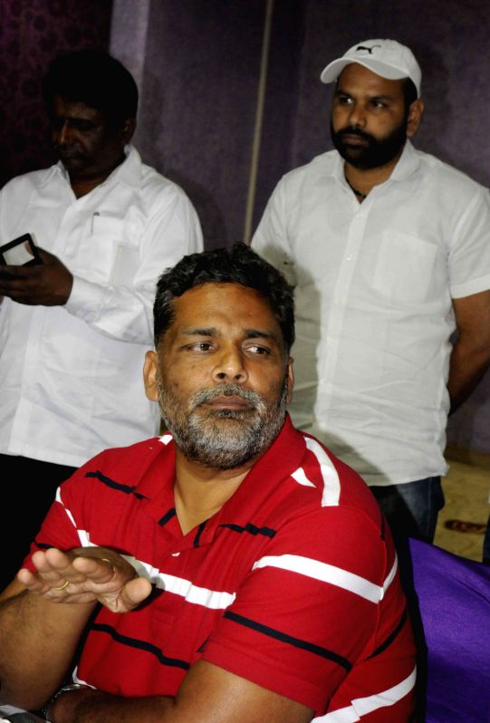 RJD MP Pappu Yadav alias Rajesh Ranjan addresses a press conference in Patna, on March 21, 2015.