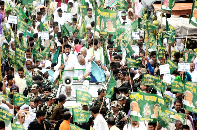 RJD workers led by party chief Lalu Prasad Yadav participate in a demonstration against the land acquisition bill in Patna, on March 15, 2015. - Lalu Prasad Yadav