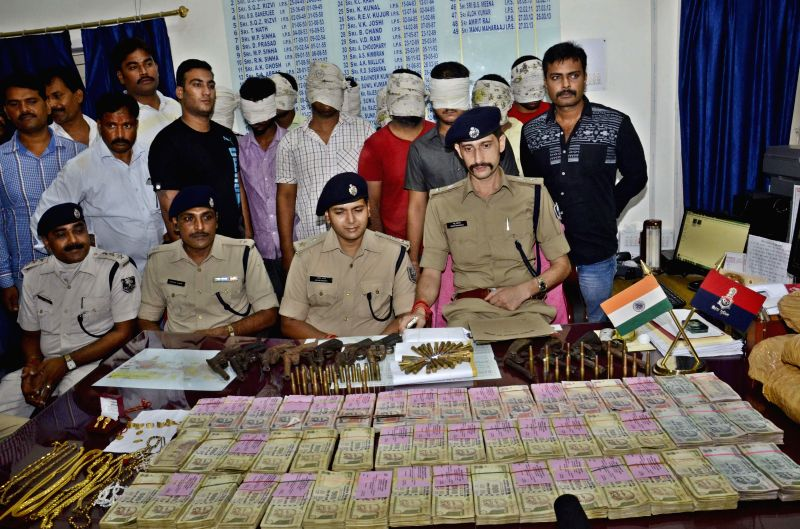 Patna Senior Superintendent of Police Manu Maharaj addresses a press conference after nabbing a gang which had robbed Rs. 1 crore from a petrol station in Patna on Aug 14, 2014.