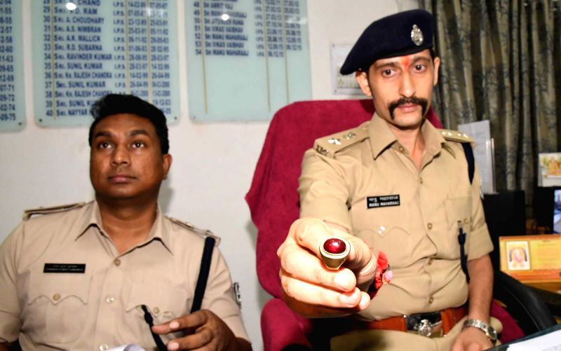 Patna Senior Superintendent of Police Manu Maharaj present before press a ruby gemstone ring seized after a robbery in Patna on April 29, 2017.