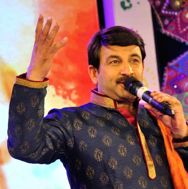 "Patna: Singer Manoj Tiwari performs during ""Rang Barse"" - a programme in Patna on programme on March 16, 2019."
