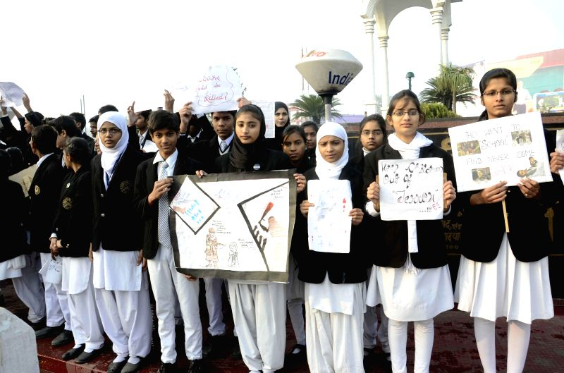 Students demonstrate against the recent terror attack on a Peshawar school that left 14 people dead, mostly children, in Patna on Dec 23, 2014.