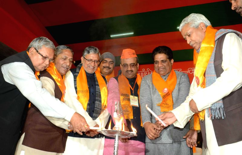 Sushil Kumar Modi and Mangal Pandey with other BJP leaders during a party programme in Patna on Jan 5, 2015. - Sushil Kumar Modi and Mangal Pandey