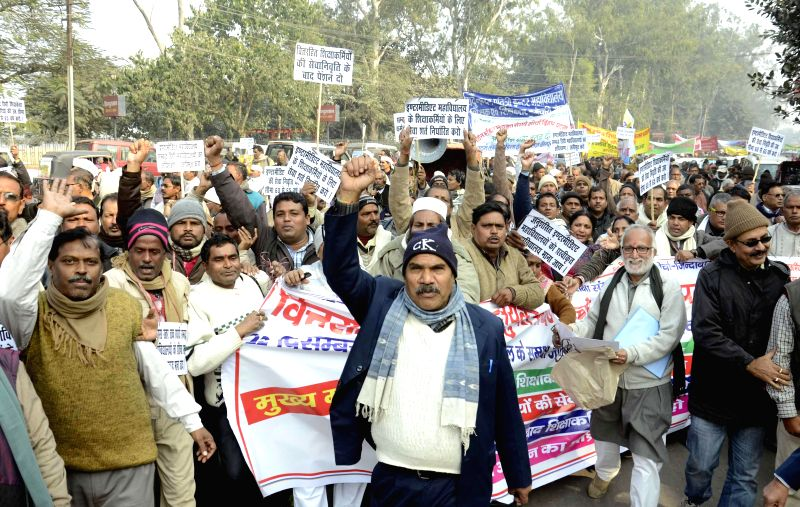 Teachers stage a demonstration outside Bihar Assembly to press for their demands in Patna, on Dec 22, 2014.