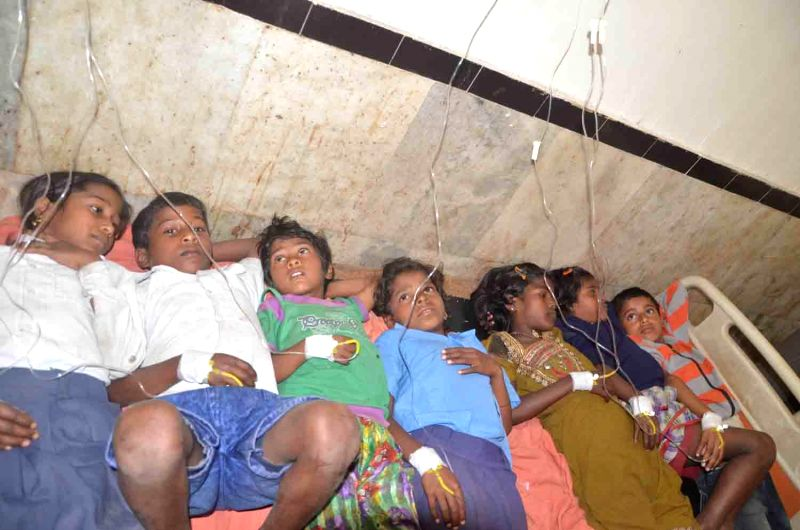 The children who fell ill after having mid-day meal at a government school being treated at Sadar hospital in Hajipur of Bihar's Vaishali district on Feb 19, 2015. At least 30 children fell ...