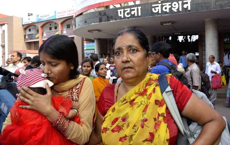 The first group of Bihar tourists, who returned from earthquake hit Nepal arrive at Patna railway station on April 27, 2015.