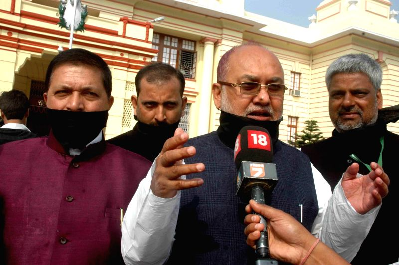 The supporters of JD(U) leader Nitish Kumar with black bands tied on their mouth gather in front of Bihar Legislative Assembly in Patna on Feb 20, 2015. - Nitish Kumar