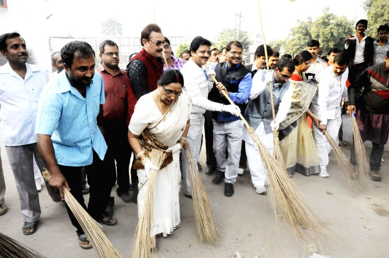 The Union MoS for HRD and Rashtriya Lok Samata Party Chief Upendra Kushwaha participates in Clean India Campaign in Patna on Nov 18, 2014.