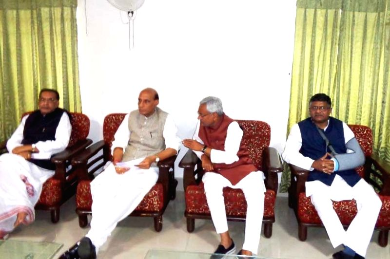 Union Home Minister Rajnath Singh, Union Minister for Telecom and Communications Ravi Shankar Prasad and Bihar Chief Minister Nitish Kumar address media after carrying out aerial survey of ... - Nitish Kumar