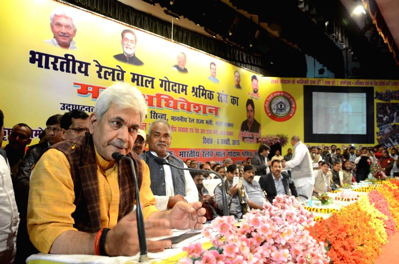 Union Minister of State for Railways Manoj Sinha addresses during a programme organised by Bihar Rajya Railway Malgodam Workers Union in Patna on Jan. 6, 2014.