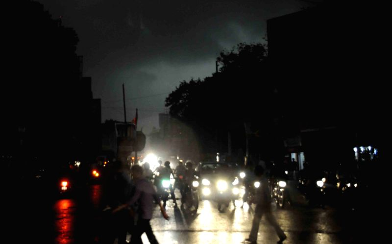 Vehicles ply with their headlights on during heavy rains in Patna on March 30, 2015.