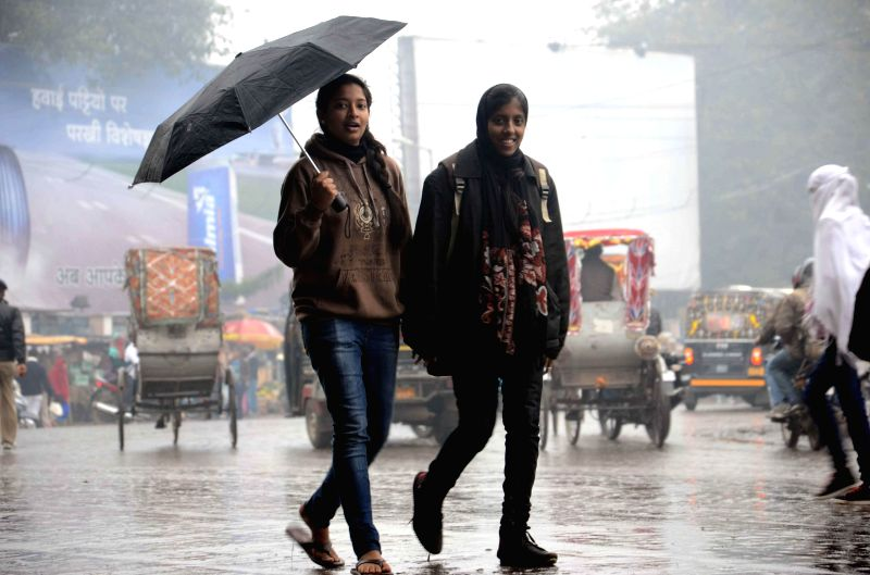 Women enjoying winter rains in Patna on Jan 3, 2015.