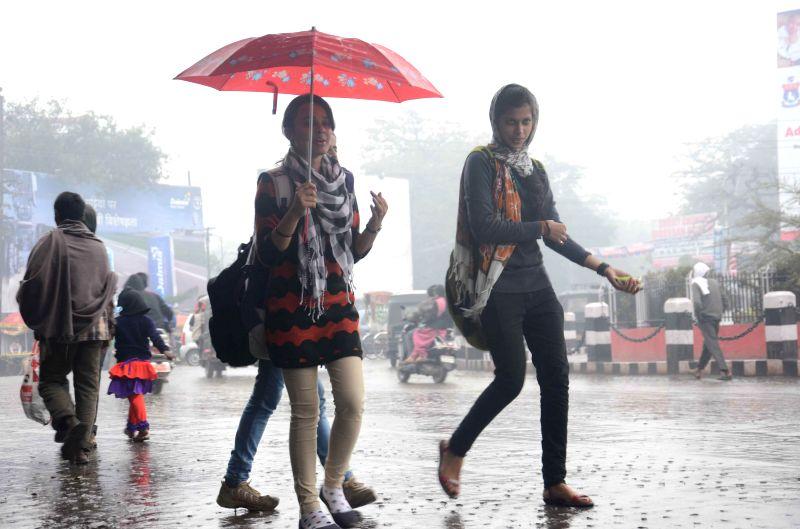 Women enjoying winter rains in Patna on Jan 3, 2015.