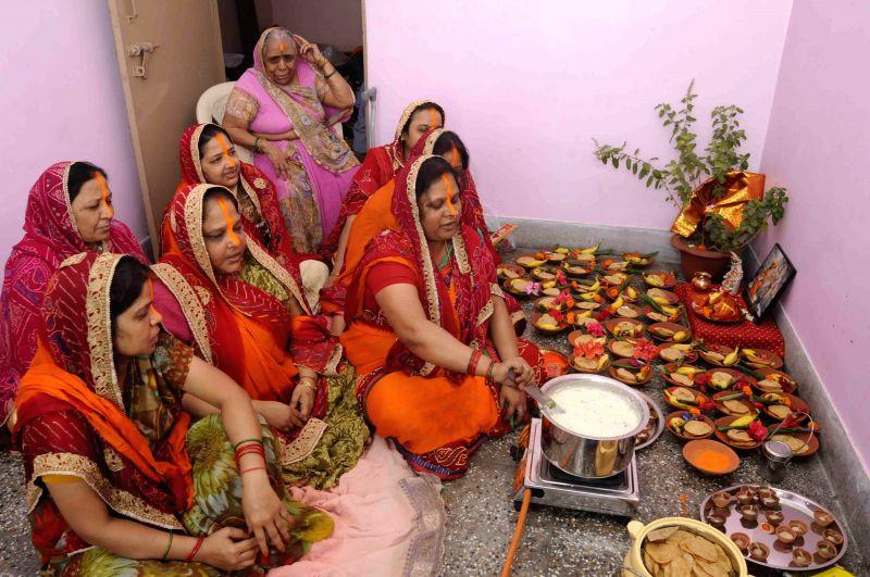 Women prepare `Prasad` on 'Kharna' day of Chhath Puja in Patna