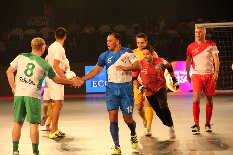 Paul Scholes (Bengaluru) and Cafu (Goa) in action during a friendly match between Marky players and Local Indian players before the the Premier Futsal League final match between Mumbai vs ...