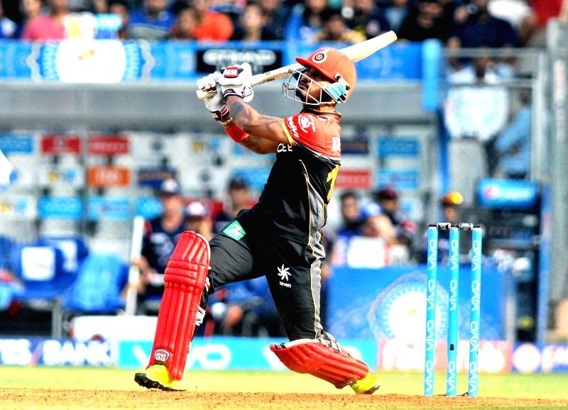 Pavan Negi of Royal Challengers Bangalore plays a shot during an IPL 2017 match between Mumbai Indians and Royal Challengers Bangalore at at Wankhede Stadium in Mumbai on May 1, 2017.