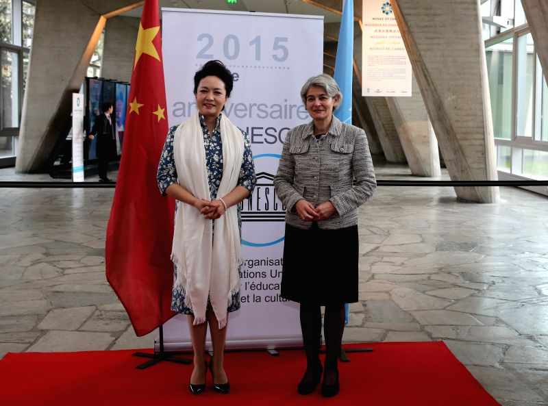 Peng Liyuan (L), Chinese President Xi Jinping's wife, is greeted by Irina Bokova, director-general of the United Nations Educational, Scientific and Cultural ...