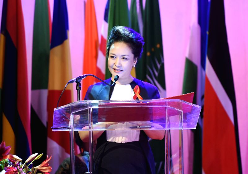 Peng Liyuan, wife of Chinese President Xi Jinping, attends an anti-AIDS advocacy activity in Johannesburg, South Africa, Dec. 5, 2015. (Xinhua/Xie ...