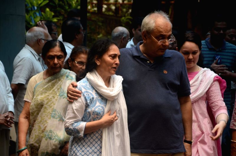 People arrive at last rites of Rajshri Media MD and CEO Rajjat Barjatya who passes away after losing a battle to cancer at Worli Crematorium in Mumbai on July 30, 2016.