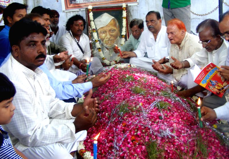 People assemble at the tomb of Shehnai maestro Ustad Bismillah Khan to read Ramayana on his death anniversary in Varanasi on Aug 21, 2014.