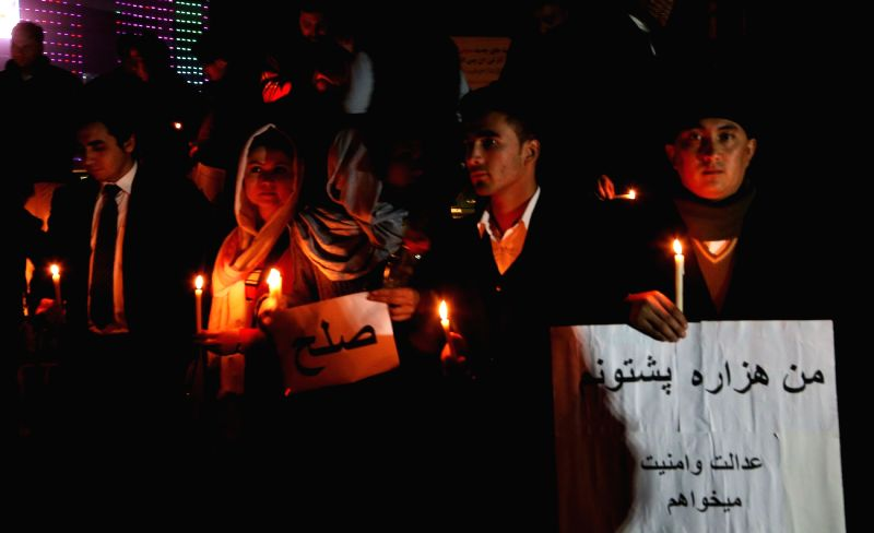 People attend a candlelight vigil to commemorate killed civilians in recent attacks, in Kabul, Afghanistan, Dec. 6, 2015. Rocket attack and mortar firing have killed ...