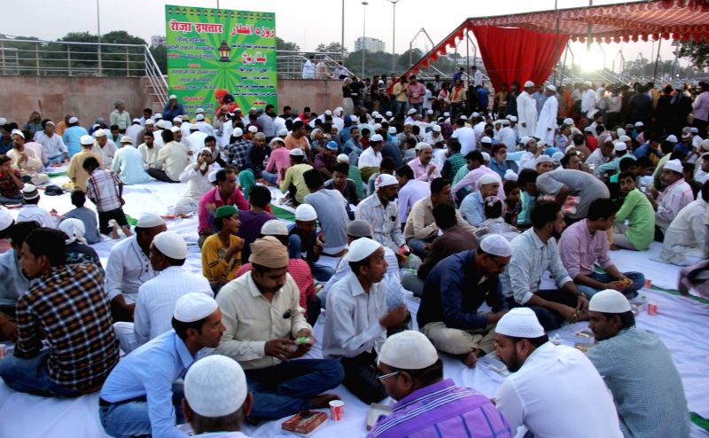 People attend an iftaar party hosted at Mankameshwar ghat in Lucknow on June 10, 2018.