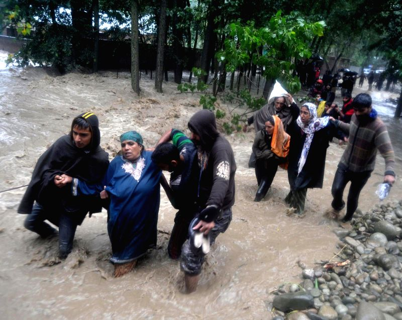 People being evacuated from Khudwani and Nowpora as water level in Vaishav nallah has increased in Kulgam district of Jammu and Kashmir on Sept 3, 2014.