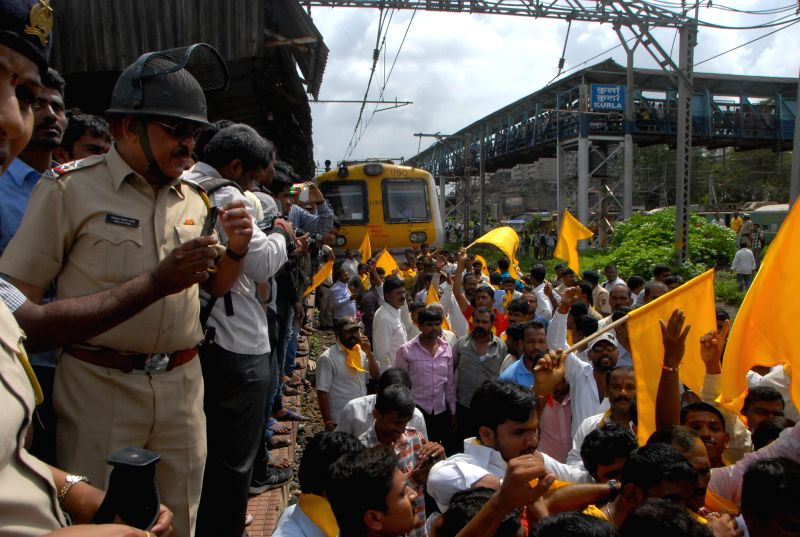 People belonging to `Dhangar` community demonstrate on railway tracks at Kurla Railway Station in Mumbai on Aug 14, 2014.