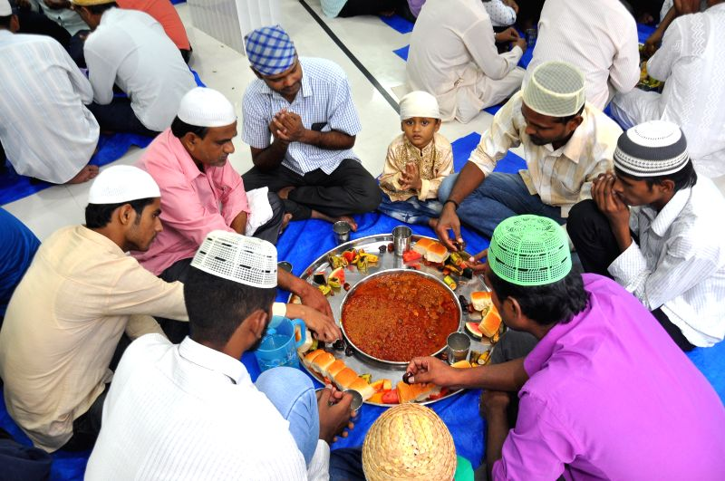 Peoples breaking their fast during iftar party