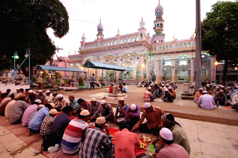 People break their fast during iftaar at Chowk Ki Masjid in Hyderabad on July 2, 2014.