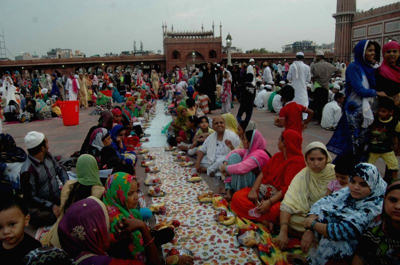 People break their fast during Ramadan at Jama Masjid in New Delhi, on June 13, 2017.
