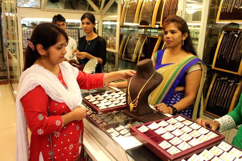 "People busy buying gold on ""Akshaya Tritiya"" in Nagpur, on May 9, 2016."