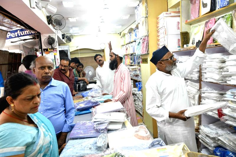 People busy shopping ahead of Eid celebration in Patna, on June 15, 2018.