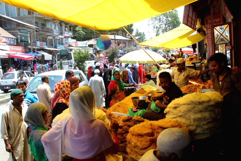 People busy shopping ahead of Eid, in Jammu and Kashmir's Pulwama on June 14, 2018.
