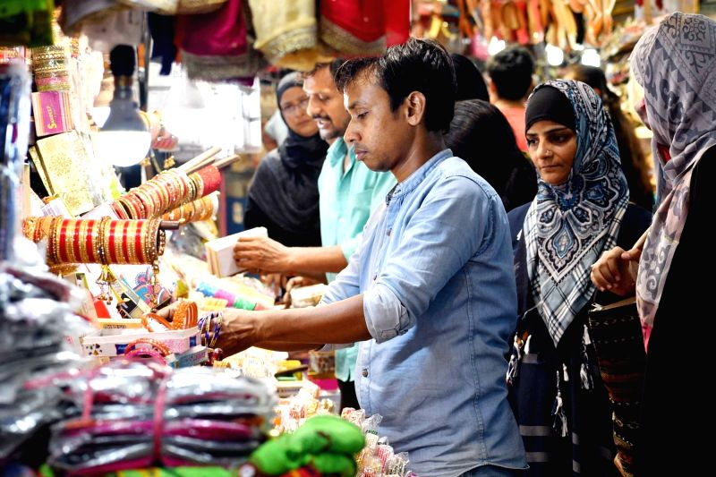 People busy shopping ahead of Eid, in Patna on June 14, 2018.