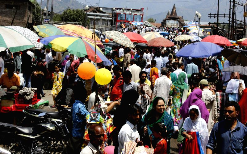 People busy shopping ahead of Eid-ul-Fitr in Srinagar on July 28, 2014.