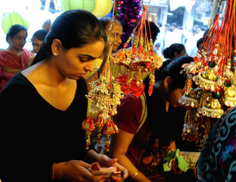 People busy shopping ahead of Raksha Bandhan at Sadar Bazar of New Delhi on Aug 8, 2014.
