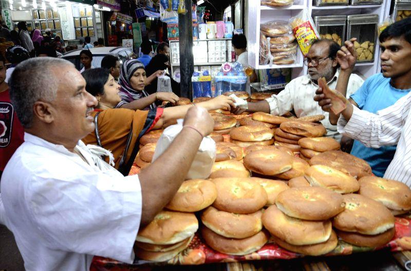 People busy shopping ahead of Ramzan in Patna on June 29, 2014.