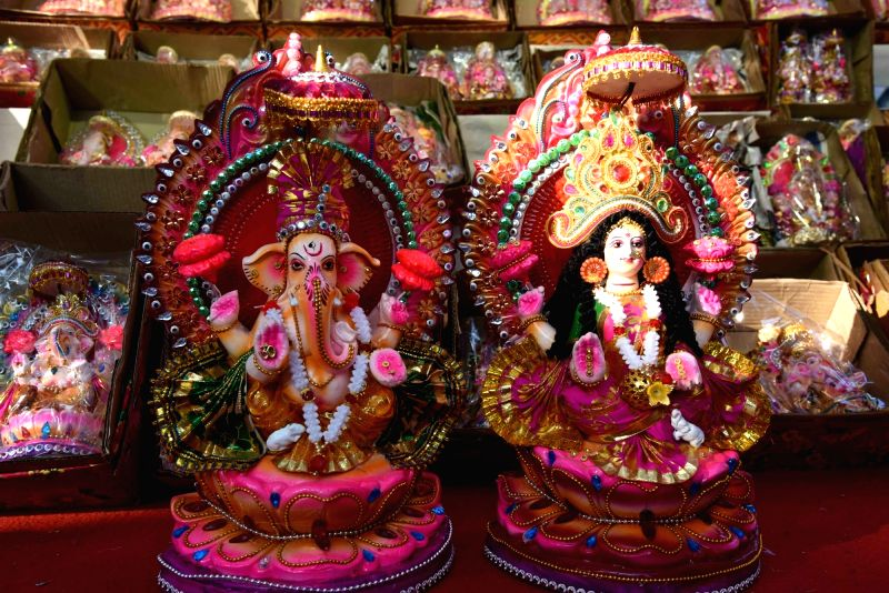 People busy shopping for earthen lamps and idols of Goddess Laxmi and Lord Ganesh ahead of Diwali celebrations, in Patna