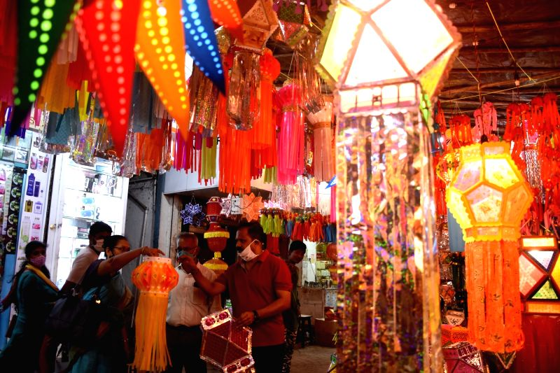 People busy shopping for lanterns and decorative lights at a market in Mumbai's Mahim ahead of Diwali celebrations