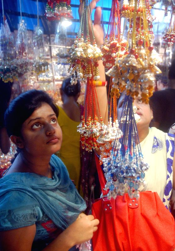 People busy shopping for Rakhi on the eve of Raksha Bandhan in Kolkata, Aug 9, 2014.