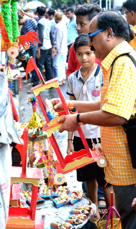 People busy shopping on the eve of Jagannath Rath Yatra in Kolkata, on July 13, 2018.