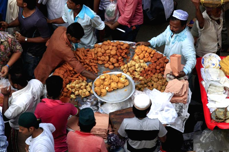 People busy shopping on the first day of Ramadan at the seasonal Iftar Bazar in Chowk Bazar of Bangladesh's Old Dhaka on June 30, 2014.