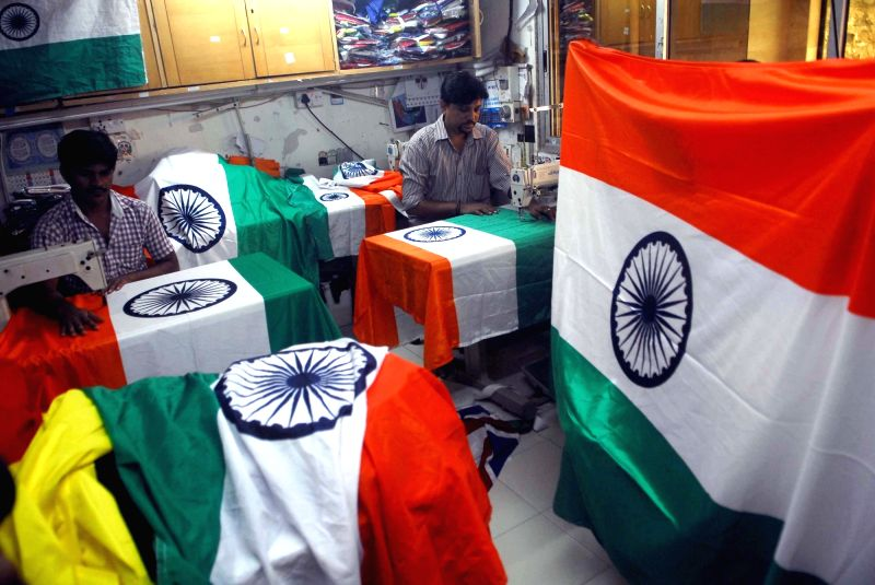 People busy stitching tricolours ahead of Independence Day at a Mumbai workshop on Aug 8, 2016.
