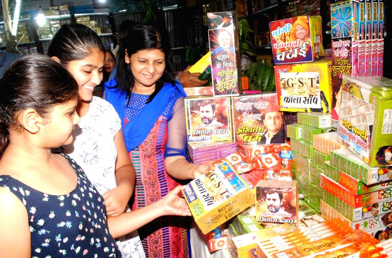 People buy fire crackers with commentary on current affairs on their packets in Allahabad on Oct 17, 2017.